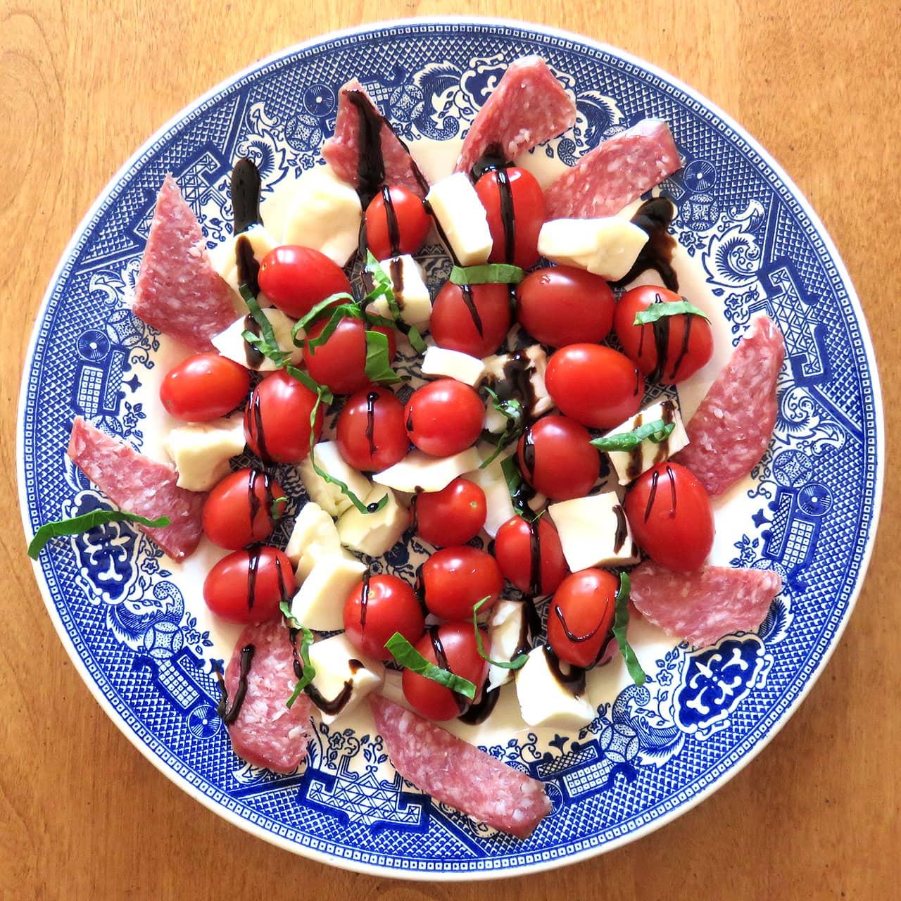 Tomato & Mozarella Salad Featuring Tusanini Balsamic Glaze